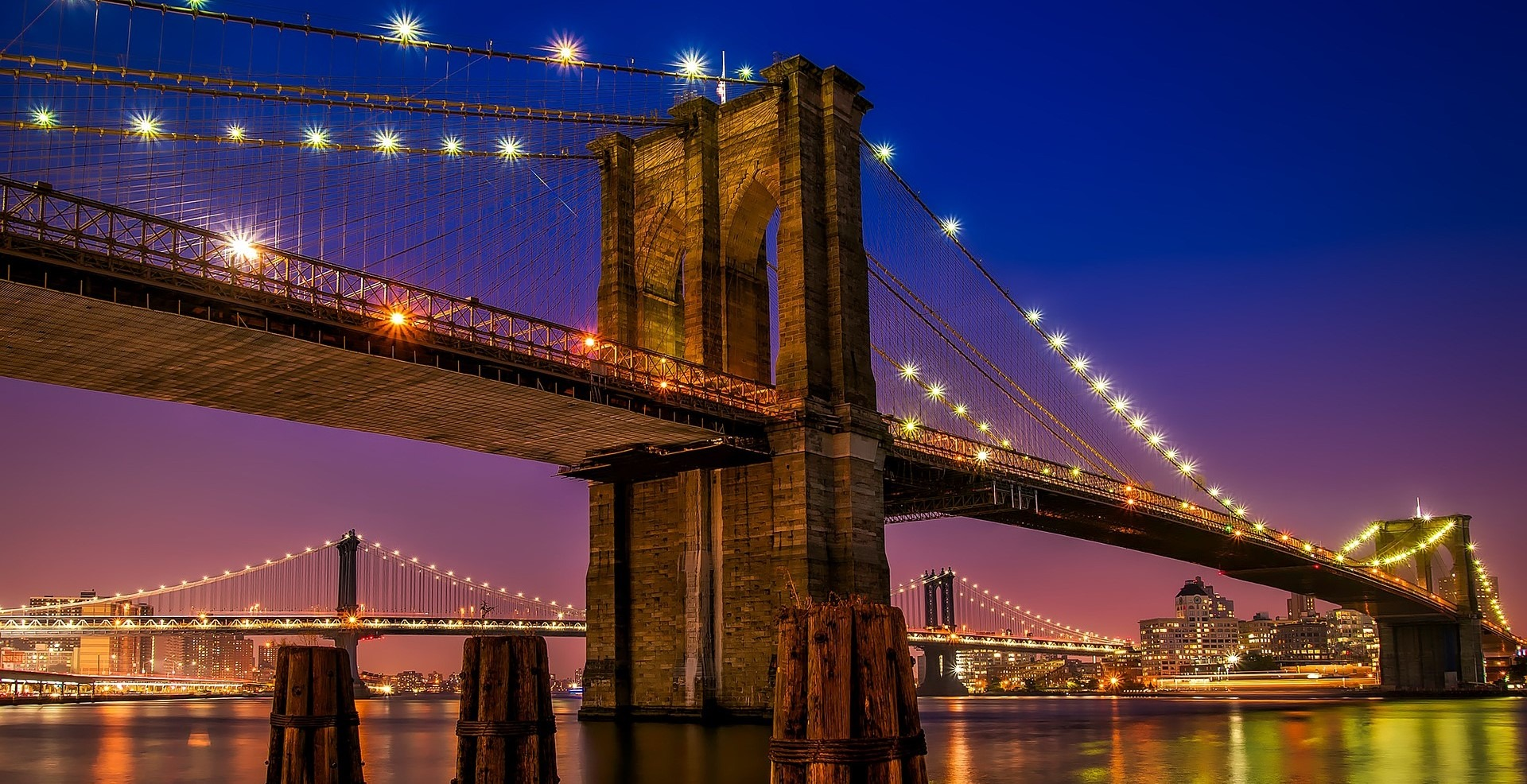 The Famous Brooklyn Bridge at Night - GoodwillCarDonation.org