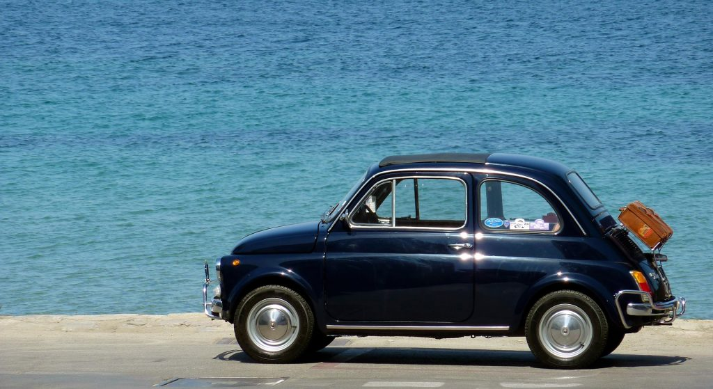 Oldtimer Fiat on a Beach side | Goodwill Car Donations
