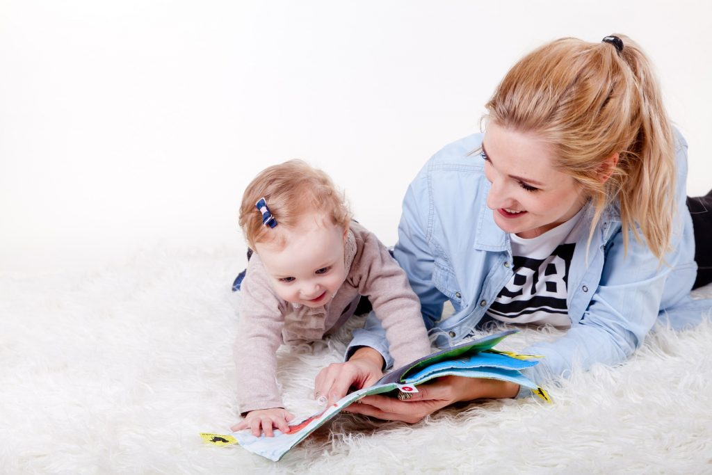 Mom and Baby Reading | Goodwill Car Donations
