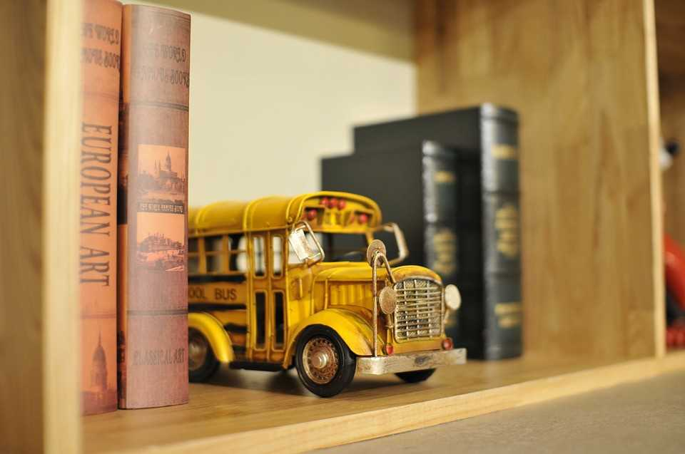Toy School Bus in a Bookshelf | Goodwill Car Donations
