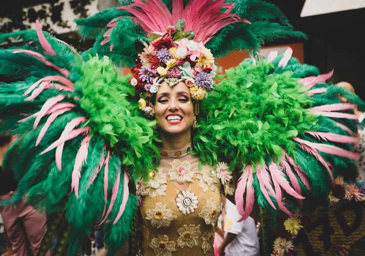 Woman Dancing on Mardi Gras | Goodwill Car Donations