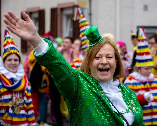 Woman Celebrating St. Patrick's Day | Goodwill Car Donations