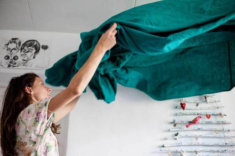 Woman Fixing Blanket   Goodwill Car Donations