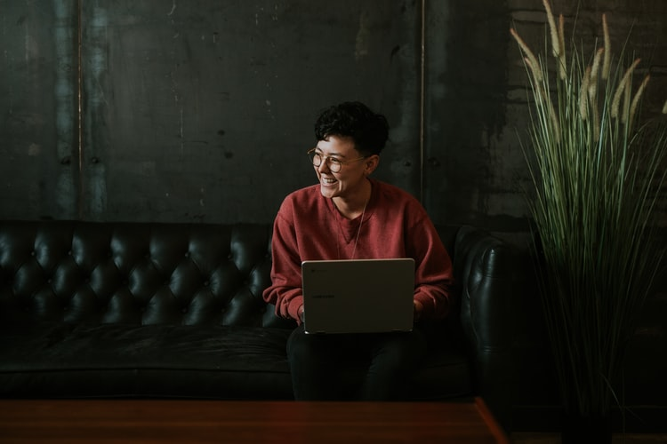 Woman and Laptop | Goodwill Car Donations