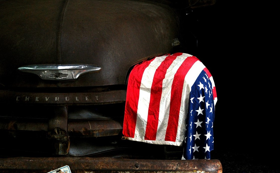 American Flag on an Old Car | Goodwill Car Donations