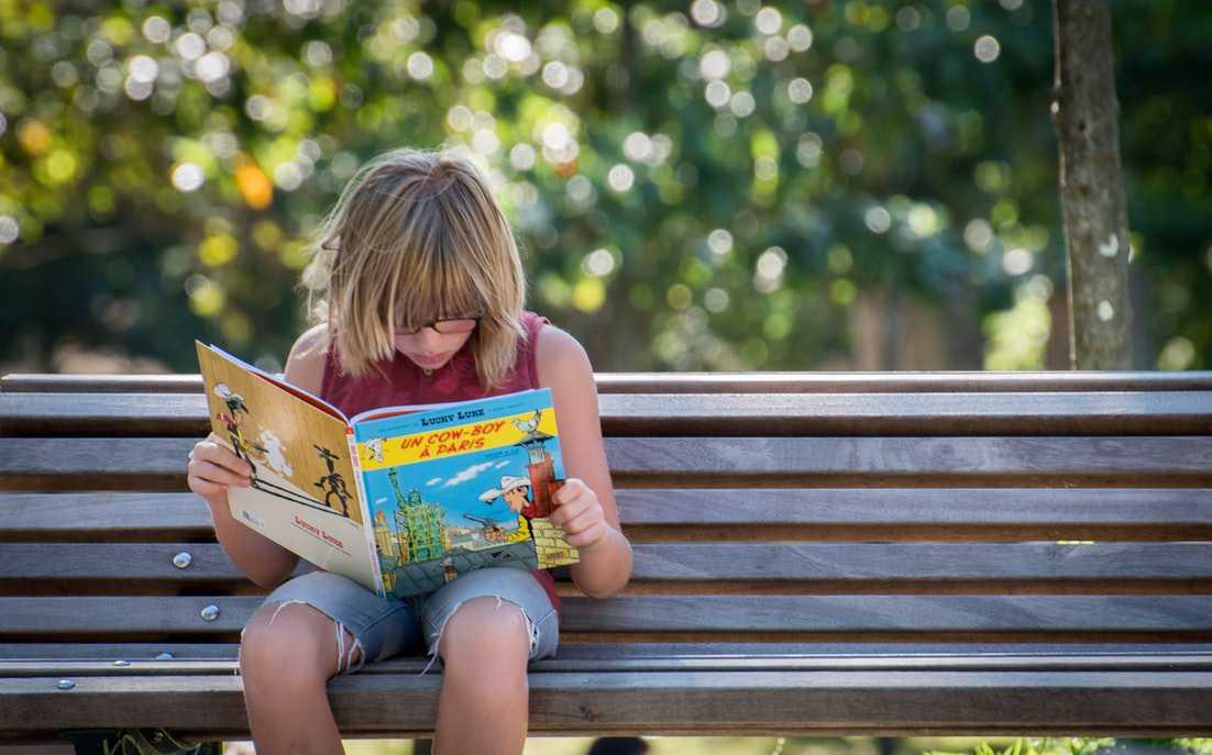 Kid Reading | Goodwill Car Donations