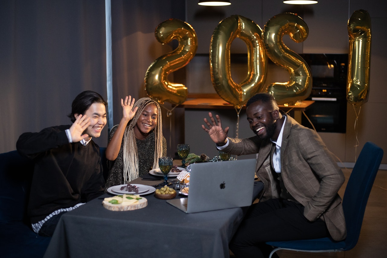 People Enjoying Virtual New Year's Party | Goodwill Car Donations