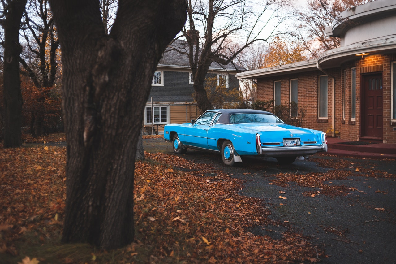 Blue Car Parked Outside the House | Goodwill Car Donations