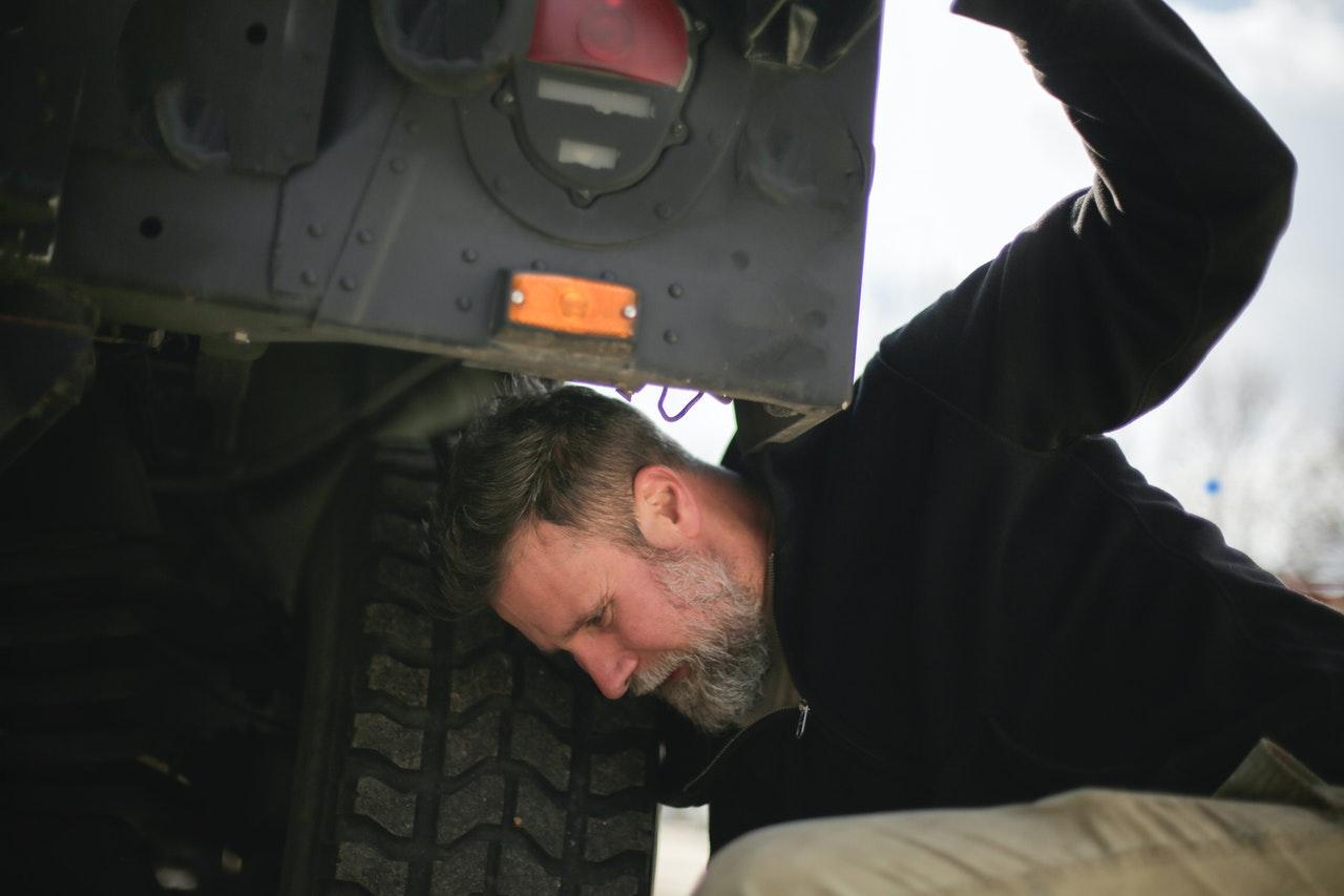 Person Checking Car Tire Pressure   Goodwill Car Donations