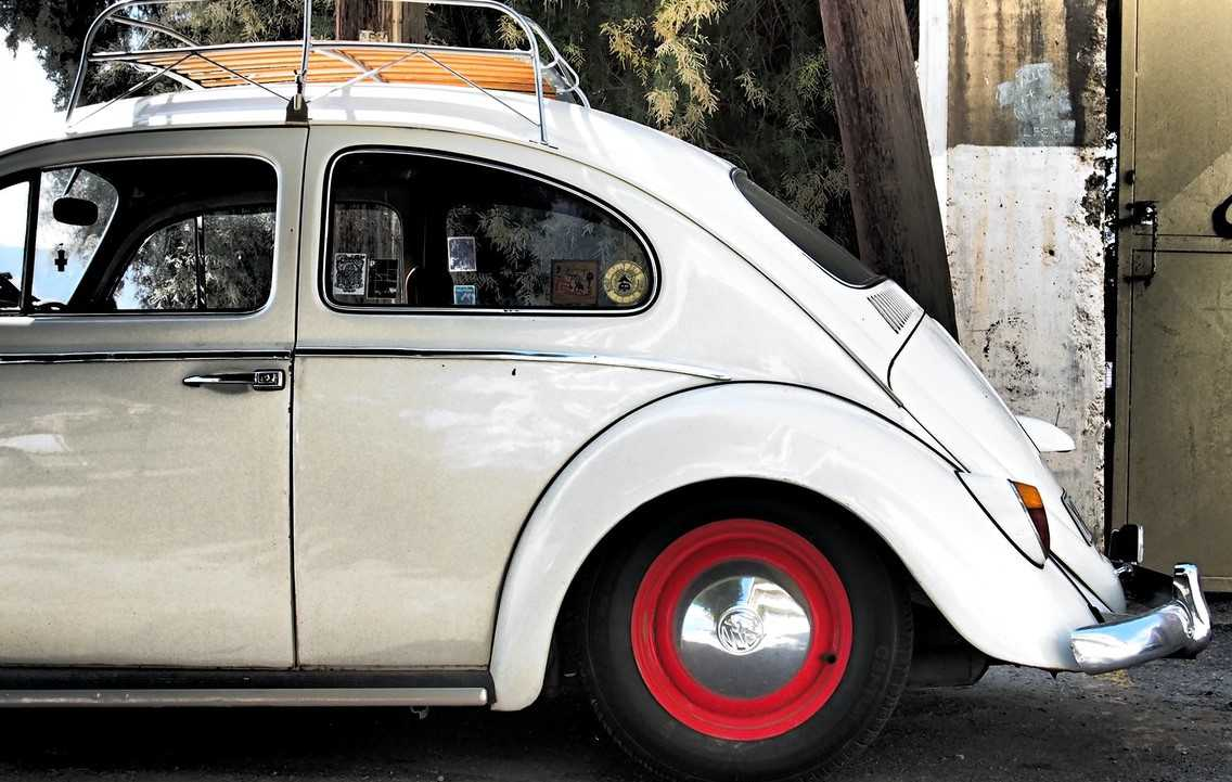 White Oldtimer Beetle Parked | Goodwill Car Donations